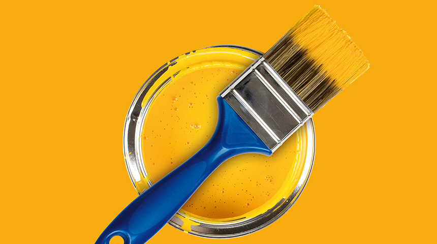Yellow paint can with brush